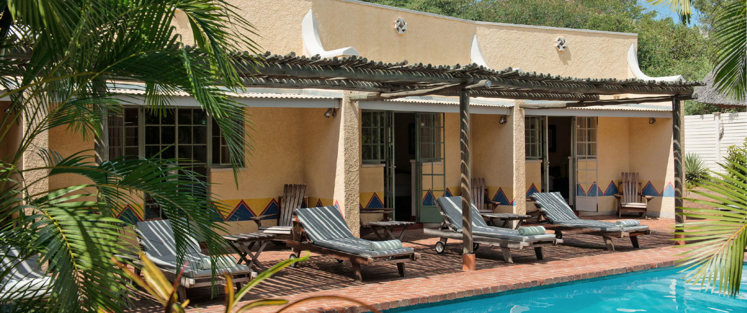 infinite_africa_travel_zimbabwe_amadeus_garden_rooms_overlooking_the_pool